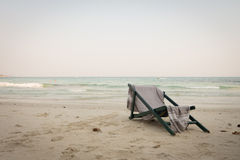 Beach chair with shawl sit on sea beach view. tone and vignet. Royalty Free Stock Image