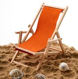 Beach chair with shellfish in white background. Beach chair with shellfish on white background Royalty Free Stock Photos