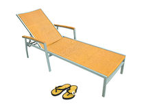 Beach chair and shoes Royalty Free Stock Photography
