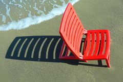 Beach chair on the shore Royalty Free Stock Photos