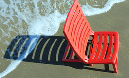 Beach chair on the shore on a warm day Royalty Free Stock Images