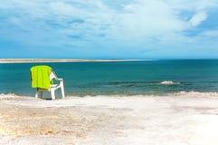 Beach chair on the shores of the Dead sea. stock photos