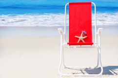 Beach chair with starfish by the ocean Royalty Free Stock Photos