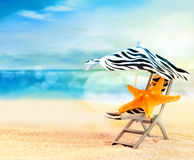 Beach chair with starfish under umbrella on the beach Royalty Free Stock Photo