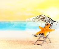 Beach chair with starfish under umbrella on the beach Royalty Free Stock Photos