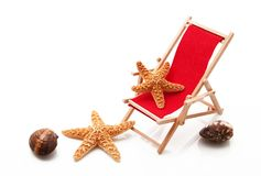 Beach chair with starfish in white background. Beach chair with starfish on white background Royalty Free Stock Photo