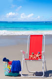 Beach chair with starfishes and bag by the ocean Stock Images