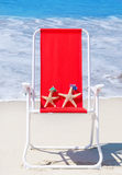 Beach chair with starfishes by the ocean Royalty Free Stock Photo