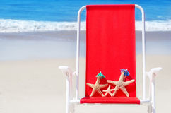 Beach chair with starfishes by the ocean Stock Images