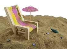 Beach chair. Still life with beach chair and umbrella on the sand Stock Image