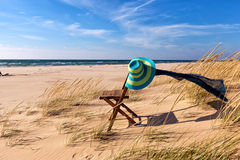 Beach Chair with Straw Hat and Scarf. Michigan USA Stock Image