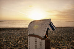 Beach chair at sunrise on the baltic Royalty Free Stock Photography