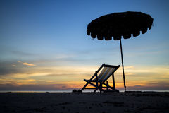 Beach chair in sunset Royalty Free Stock Image