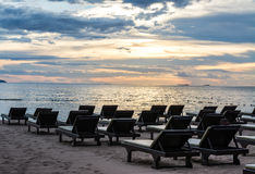 Beach chair in sunset scene Royalty Free Stock Photos