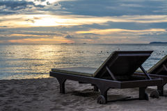Beach chair in sunset scene Royalty Free Stock Image