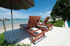 Beach chair. The beach chair beside the beach in Thailand royalty free stock photo