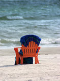 Beach chair and towel. Orange beachchair and towel. Florida Gulf Coast stock images