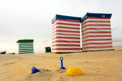 Beach chair and toys at the sea Stock Images