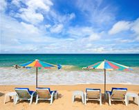 Beach chair in tropical sea Stock Images
