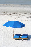 Beach chair with umbrella Royalty Free Stock Images