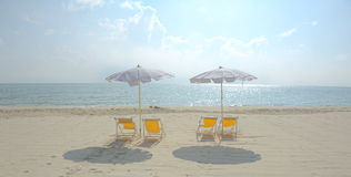 Beach chair and umbrella Stock Photos