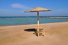 Beach chair with umbrella Royalty Free Stock Photography