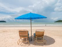 Beach Chair with Umbrella on the Beach. Beach Chair with Blue Umbrella on the beach, weather condition is Sunny Day. Location in Langkawi Malaysia royalty free stock photos