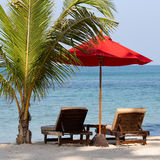 Beach chair and umbrella on the beach in sunny day , Thailand Royalty Free Stock Photo