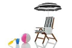 Beach chair with umbrella and beach toys Stock Image