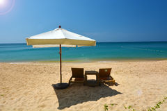 Beach chair. And umbrella on idyllic tropical sand beach stock image