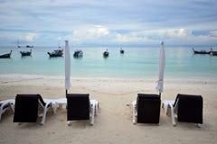 Beach chair and umbrella on idyllic tropical sand beach. Lipe, T Royalty Free Stock Photography