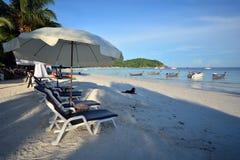 Beach chair and umbrella on idyllic tropical sand beach Stock Photos