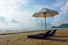 Beach chair and umbrella on Pranburi beach Royalty Free Stock Photography