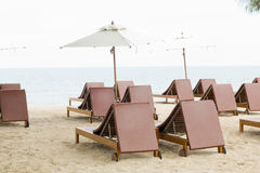 Beach chair and umbrella on sand beach. Concept for rest, relaxa Stock Photography
