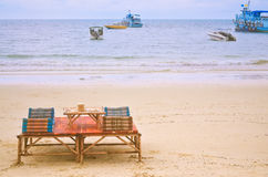 Beach chair and umbrella on sand beach. Concept for rest, relaxa Royalty Free Stock Photography