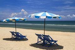 Beach chair and umbrella on sand beach Royalty Free Stock Image