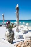Beach chair and umbrella on  sandy beach Royalty Free Stock Photo