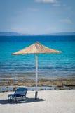 Beach chair and umbrella on  sandy beach Stock Photo