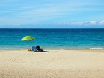 Beach chair with umbrella on the  shore Stock Image