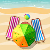 Beach chair and umbrella top view Stock Images