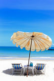 Beach chair and umbrella on tropical sand beach Royalty Free Stock Photos