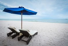 Beach chair and umbrella Stock Images