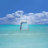 Beach Chair in the Water Royalty Free Stock Images
