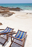 Beach chair on white sand Stock Photography