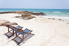 Beach chair on white sand Stock Image