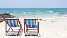 Beach chair on white sand Stock Images