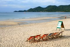 Beach Chair on the white sand beach Stock Photos