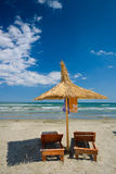 Beach chair. On White sand blue sea background at Navodari, Constanta - Romania stock photos