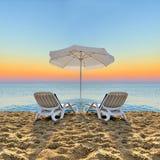 Beach chair and white umbrella on beach Stock Image