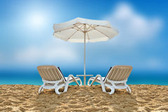 Beach chair and white umbrella on beach Royalty Free Stock Images